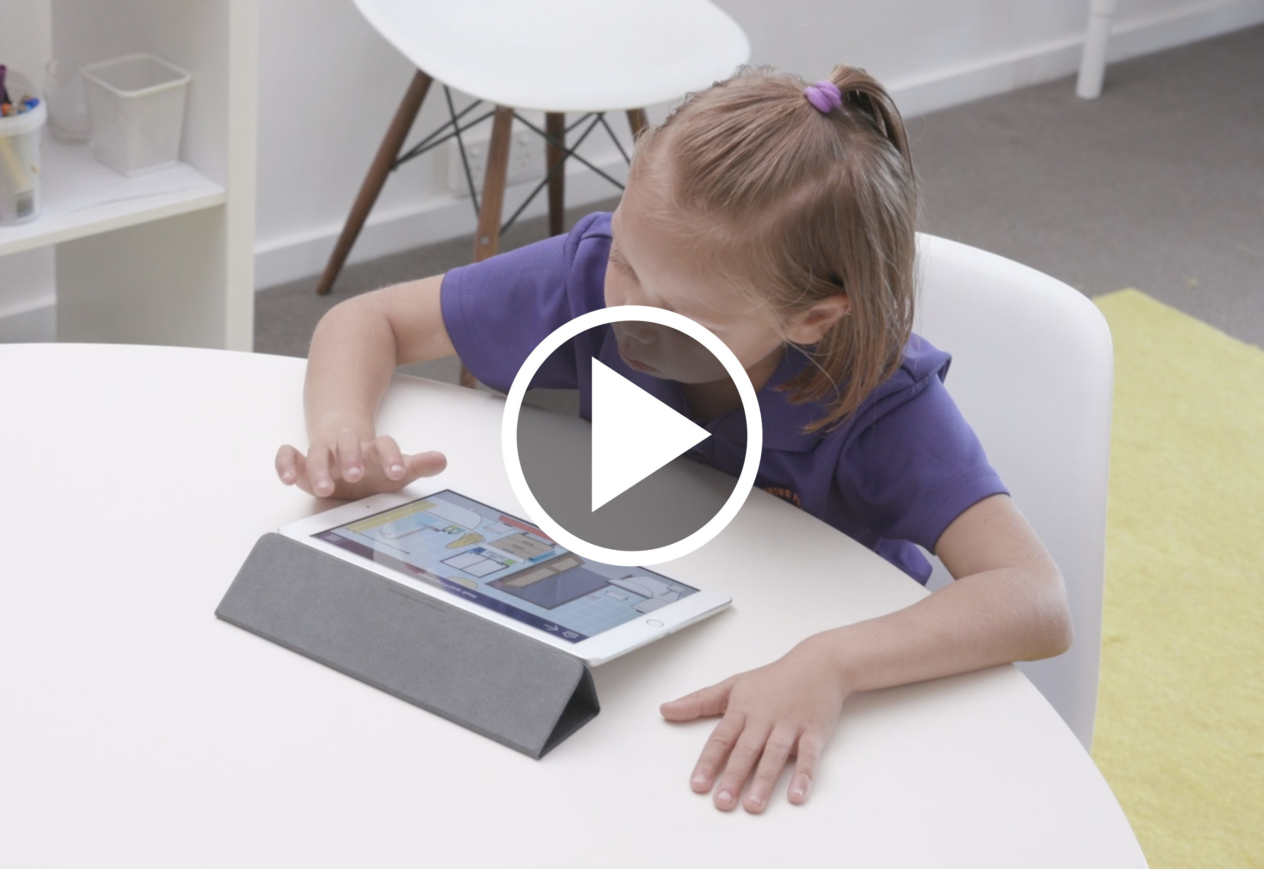 Young girl using the SECCA App on an ipad at a table